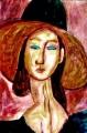 1大きな帽子を被ったジャンヌ・エビュテルヌ