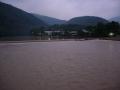 140813増水した早朝の桂川渡月橋より