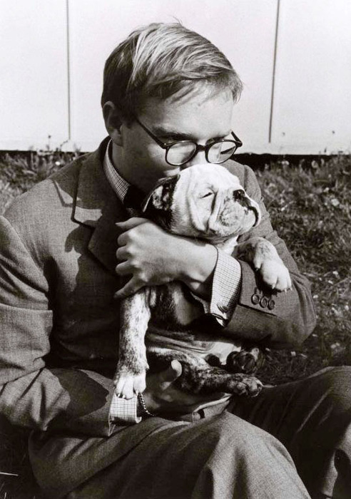 Truman Capote holding a pet dog, Italy, 1953 -by Robert Capa