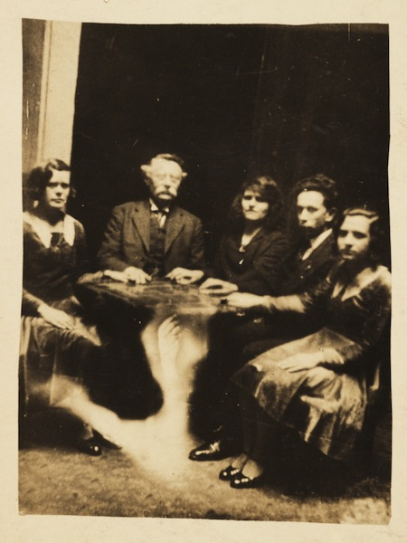 A photograph of a group gathered at a seance taken by William Hope (1863-1933) in about 1920