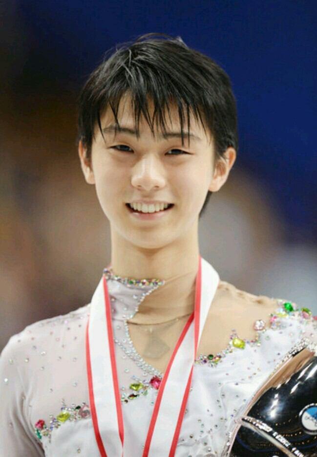 ソチオリンピックで金メダルを手にした羽生結弦